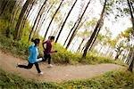 Women Running on Forest Trail, Seattle, Washington, USA