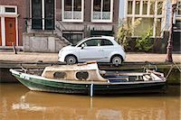 Car and Boat, Amsterdam, Netherlands                                                                                                                                                                     Stock Photo - Premium Rights-Managednull, Code: 700-03018137