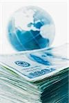 Stack of banknotes and globe Stock Photo - Premium Royalty-Free, Artist: Ken Davies, Code: 614-03020585