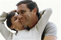 preteen kissing - Girl kissing her father on cheek Stock Photo - Premium Royalty-Freenull, Code: 632-03026949