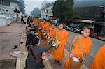 Buddhist monks collecting alms in the early morning, Luang Prabang, Laos, Indochina, Southeast Asia, Asia                                                                                                Stock Photo - Premium Rights-Managed, Artist: Robert Harding Images    , Code: 841-03028363