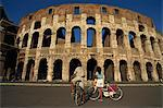 Couple admiring the Colosseum on bike ride, Rome, Lazio, Italy,Europe                                                                                                                                    Stock Photo - Premium Rights-Managed, Artist: Robert Harding Images    , Code: 841-03029219