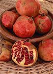 Still life of a bowl of red pomegranates, with one fruit cut in half to show seeds, in Andalucia (Andalusia), Spain, Europe                                                                              Stock Photo - Premium Rights-Managed, Artist: Robert Harding Images    , Code: 841-03030371