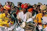 Musicians playing the dhol and poongi, Bikaner Desert Festival, Rajasthan state, India, Asia