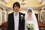 Bride Standing with Groom in Church                                                                                                                                                                      Stock Photo - Premium Rights-Managed, Artist: Aflo Relax               , Code: 859-03039163