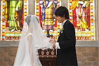 Groom Lifting Veil                                                                                                                                                                                       Stock Photo - Premium Rights-Managednull, Code: 859-03039173
