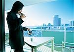 Woman Having Breakfast On A Terrace                                                                                                                                                                      Stock Photo - Premium Rights-Managed, Artist: Aflo Relax               , Code: 859-03041753