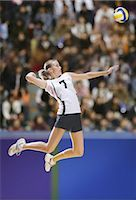 spike - Volleyball Player Striking Mid-Air                                                                                                                                                                       Stock Photo - Premium Rights-Managednull, Code: 858-03046889