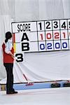 Curler Looking at Scoreboard