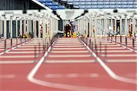 Runner on competitive track                                                                                                                                                                              Stock Photo - Premium Rights-Managednull, Code: 858-03050040
