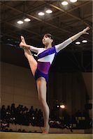 Young woman standing on balance beam                                                                                                                                                                     Stock Photo - Premium Rights-Managednull, Code: 858-03050244