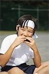 Child Eating Riceball                                                                                                                                                                                    Stock Photo - Premium Rights-Managed, Artist: Aflo Sport               , Code: 858-03050403