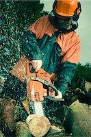 Man Cutting Tree with Chainsaw Stock Photo - Premium Royalty-Freenull, Code: 600-03053768