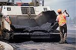 Worker Shovelling Asphalt for Road Paving, Calgary, Alberta, Canada                                                                                                                                      Stock Photo - Premium Rights-Managed, Artist: Gloria H. Chomica        , Code: 700-03053774