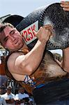 Weight lifting in strong man competition, during San Fermin, Running of the Bulls Festival, Pamplona, Navarra, Euskadi, Spain, Europe                                                                    Stock Photo - Premium Rights-Managed, Artist: Robert Harding Images    , Code: 841-03054949