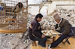 Men playing a board game in a neighbourhood Hutong partially destroyed and marked for demolition, Beijing, China, Asia                                                                                   Stock Photo - Premium Rights-Managed, Artist: Robert Harding Images    , Code: 841-03055753