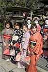 Girls wearing yukata - kimono, geisha, maiko (trainee geisha) in Gion, Kyoto city, Honshu, Japan, Asia                                                                                                   Stock Photo - Premium Rights-Managed, Artist: Robert Harding Images    , Code: 841-03056239