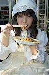 Tokyo subculture, teenage girl eating noodles, Harajuku, Yoyogi koen park, Tokyo, Honshu, Japan, Asia                                                                                                    Stock Photo - Premium Rights-Managed, Artist: Robert Harding Images    , Code: 841-03056322