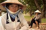 Lady wearing conical hat, Hanoi, Northern Vietnam, Southeast Asia, Asia                                                                                                                                  Stock Photo - Premium Rights-Managed, Artist: Robert Harding Images    , Code: 841-03056656