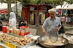 Food vendor frying food outside Central Market, Kuala Lumpur, Malaysia, Southeast Asia, Asia                                                                                                             Stock Photo - Premium Rights-Managed, Artist: Robert Harding Images    , Code: 841-03056948