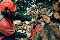 Man Cutting Tree with Chainsaw, Devon, England Stock Photo - Premium Royalty-Freenull, Code: 600-03059106