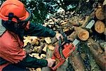 Man Cutting Tree with Chainsaw, Devon, England Stock Photo - Premium Royalty-Free, Artist: Matt Brasier             , Code: 600-03059106