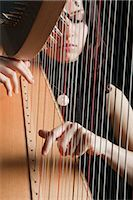 Woman Playing the Harp                                                                                                                                                                                   Stock Photo - Premium Rights-Managednull, Code: 700-03059198