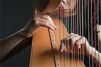 Woman Playing the Harp                                                                                                                                                                                   Stock Photo - Premium Rights-Managednull, Code: 700-03059199