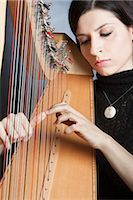Woman Playing the Harp                                                                                                                                                                                   Stock Photo - Premium Rights-Managednull, Code: 700-03059200