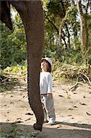 Two year old girl and the elephant that will take her on safari, at the Island Jungle Resort hotel, Royal Chitwan National Park, Terai, Nepal, Asia                                                      Stock Photo - Premium Rights-Managednull, Code: 841-03062394
