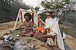 Two Sadhus smoke marijuana on the one day of the year when it is legal, during the Hindu festival of Shivaratri, Pashupatinath, Kathmandu, Nepal, Asia                                                   Stock Photo - Premium Rights-Managed, Artist: Robert Harding Images    , Code: 841-03062407