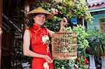 Chinese woman, Lijiang, Shangri-La region, Yunnan province, China, Asia                                                                                                                                  Stock Photo - Premium Rights-Managed, Artist: Robert Harding Images    , Code: 841-03065057