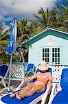Beach cabana and woman, Princess Cays, Eleuthera Island, Bahamas, West Indies, Central America                                                                                                           Stock Photo - Premium Rights-Managed, Artist: Robert Harding Images    , Code: 841-03065945