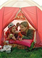 Mother and Daughter Eating inside Tent                                                                                                                                                                   Stock Photo - Premium Rights-Managednull, Code: 700-03067832