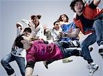 Group of Young Adults Jumping in Air Stock Photo - Premium Rights-Managed, Artist: Brian Kuhlmann           , Code: 700-03068087