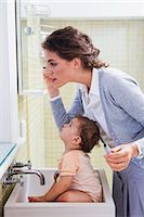 Mother with Baby Applying Make-up Stock Photo - Premium Rights-Managednull, Code: 700-03068739