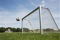 Soccer Ball and Net Stock Photo - Premium Royalty-Freenull, Code: 600-03069341