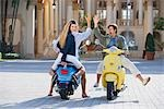 Three friends having fun on mopeds,Biltmore Hotel,Coral Gables,Florida,USA                                                                                                                               Stock Photo - Premium Rights-Managed, Artist: Glowimages               , Code: 837-03069514