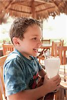 preteen  smile  one  alone - Boy drinking lemonade and smiling                                                                                                                                                                        Stock Photo - Premium Rights-Managed, Artist: Glowimages, Code: 837-03070141