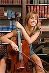 Woman playing a cello in a library                                                                                                                                                                       Stock Photo - Premium Rights-Managed, Artist: Glowimages               , Code: 837-03070206