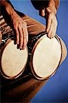 Close-up of a man playing a bongo                                                                                                                                                                        Stock Photo - Premium Rights-Managed, Artist: Glowimages               , Code: 837-03070222