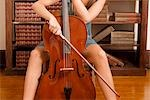 Woman playing a cello in a library                                                                                                                                                                       Stock Photo - Premium Rights-Managed, Artist: Glowimages               , Code: 837-03070411