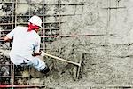 High angle view of a construction worker working at a construction site                                                                                                                                  Stock Photo - Premium Rights-Managed, Artist: Glowimages               , Code: 837-03070465