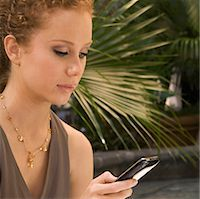 Woman text messaging on a mobile phone,Biltmore Hotel,Coral Gables,Florida,USA                                                                                                                           Stock Photo - Premium Rights-Managednull, Code: 837-03070635