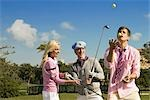 Three friends having fun in a golf course,Biltmore Golf Course,Coral Gables,Florida,USA                                                                                                                  Stock Photo - Premium Rights-Managed, Artist: Glowimages               , Code: 837-03070787