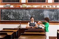pre-teen boy models - Schoolboy and his teacher with model of solar system in a classroom                                                                                                                                      Stock Photo - Premium Rights-Managednull, Code: 837-03071010