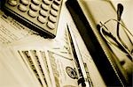 Close-up of a pen with a calculator and eyeglasses on a financial newspaper                                                                                                                              Stock Photo - Premium Rights-Managed, Artist: Glowimages               , Code: 837-03071035