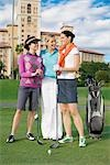 Three golfers standing in a golf course and smiling,Biltmore Golf Course,Biltmore Hotel,Coral Gables,Florida,USA                                                                                         Stock Photo - Premium Rights-Managed, Artist: Glowimages               , Code: 837-03071288