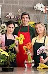 Two female florists with a male florist smiling                                                                                                                                                          Stock Photo - Premium Rights-Managed, Artist: Glowimages               , Code: 837-03071363