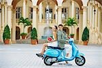 Couple sitting on a moped,Biltmore Hotel,Coral Gables,Florida,USA                                                                                                                                        Stock Photo - Premium Rights-Managed, Artist: Glowimages               , Code: 837-03071438